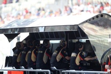 The Lotus F1 team on the pit wall.