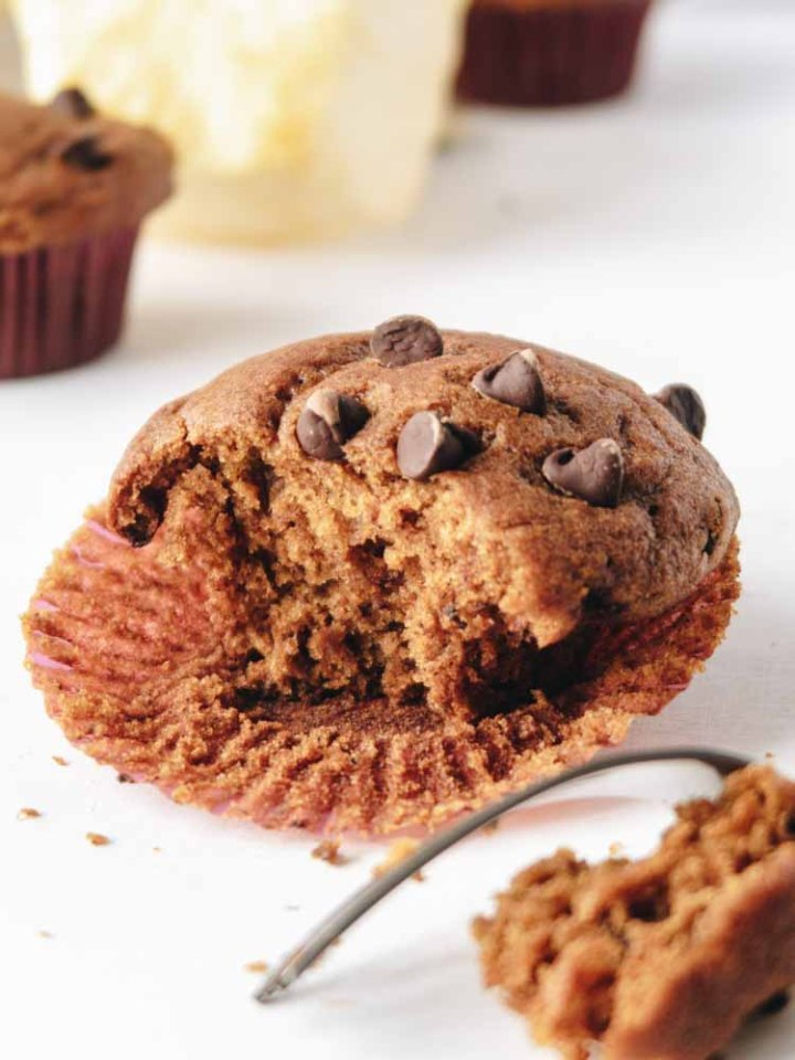 A Vegan Pumpkin Muffins with Chocolate Chips with a bite taken