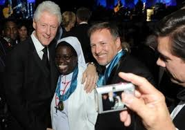AP Photo: Former President Bill Clinton poses with Sr. Rosemary