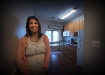 Beth Hodge, executive director of the Loudoun Homeless Services Center, stands in one of the permanent supportive housing units, credited with getting chronically homeless people off the streets permanently. (Douglas Graham/Loudoun Now)