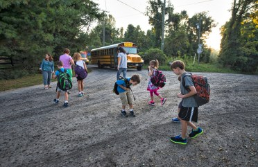 Kids who leave near North Fork and Shelburne Glebe roads in western Loudoun were up early Monday as they navigated changes to their bus schedules. [Douglas Graham/Loudoun Now]