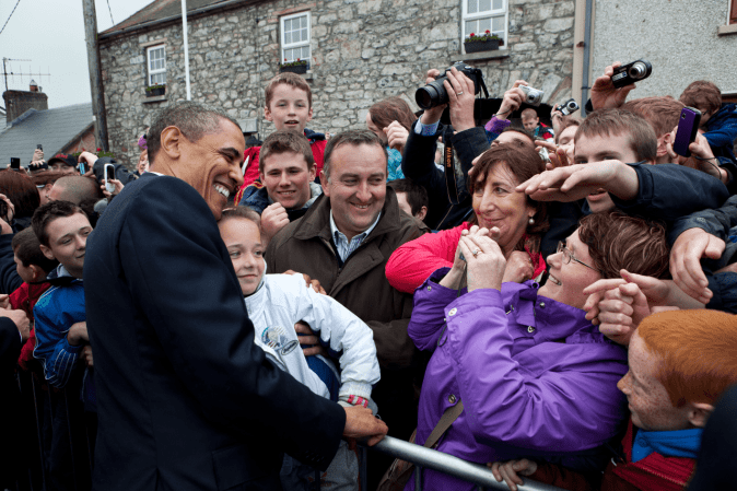 Barack_Obama_poses_for_a_photograph_in_Moneygall-min