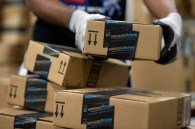 An employee stacks items to be shipped at the Amazon.com Inc. fulfillment center in Phoenix, Arizona, U.S. on, Sunday, Dec. 1, 2013. More than 131 million consumers are expected to shop Cyber Monday events, up from 129 million last year, according to the National Retail Federation. Photographer: David Paul Morris/Bloomberg via Getty Images