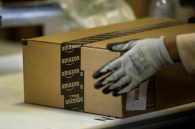 An employee seals a box at the Amazon.com Inc. fulfillment center in Phoenix, Arizona, U.S. on Monday, Dec. 2, 2013. More than 131 million consumers are expected to shop Cyber Monday events, up from 129 million last year, according to the National Retail Federation. Photographer: David Paul Morris/Bloomberg via Getty Images