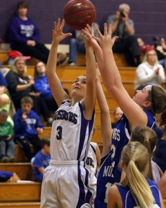 Madilyn Melton leaps for a rebound during the Lady Cats'  Nov. 23 game against Wheatridge.