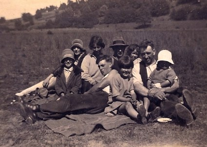 A family picnic. My grandfather is the one reclining centre-front.