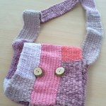 Pink & lilac woven handbag made at a Carrie Dennison workshop
