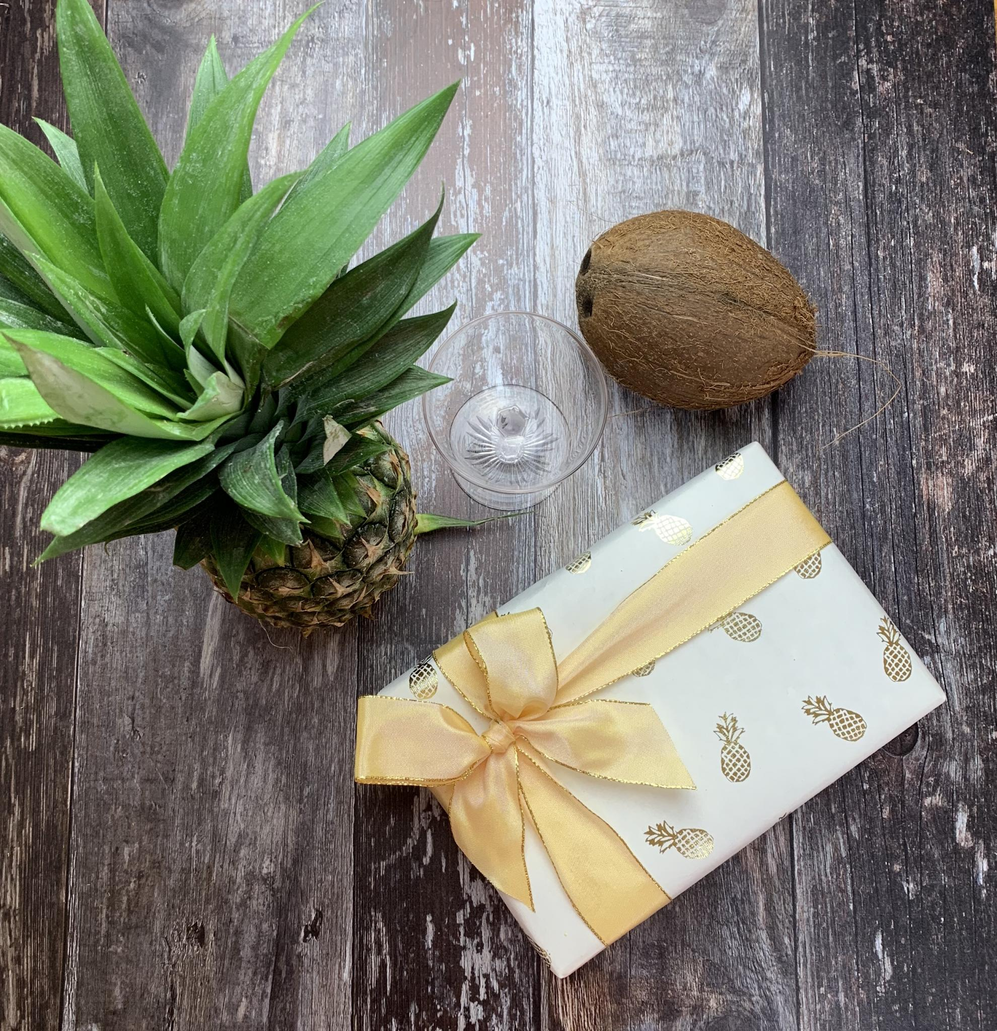 Pineapple giftwrapped box with a fresh pineapple, coconut & cocktail glass