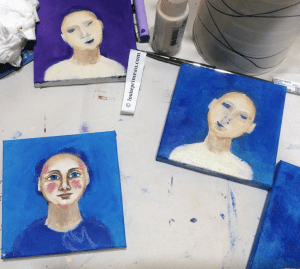 A face emerges from the series of acrylic portraits