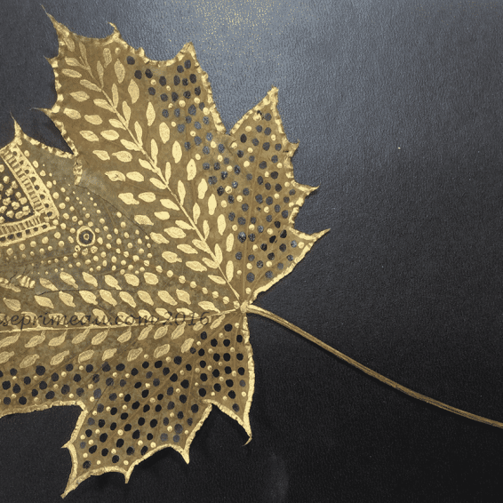 gold and black acrylic on autumn leaf