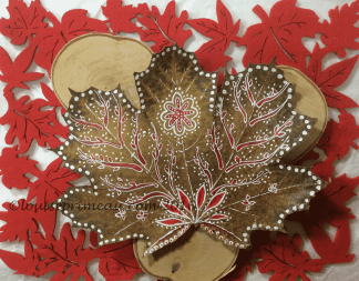 acrylic paint on autumn leaf in red and white