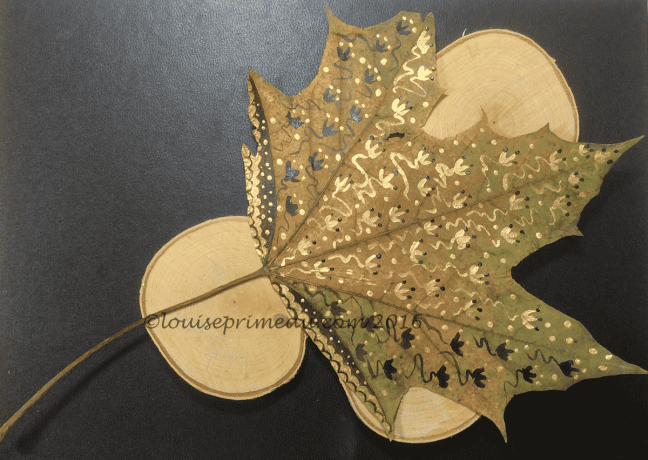 gold doodles on maple leaf