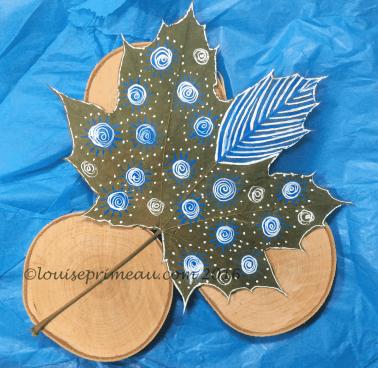 acrylic doodles on autumn leaf