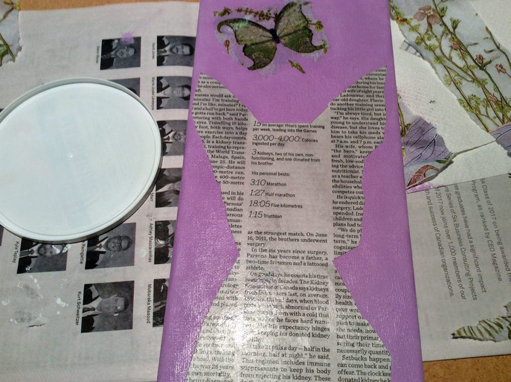 collage newspaper outline of dog on prepped canvas