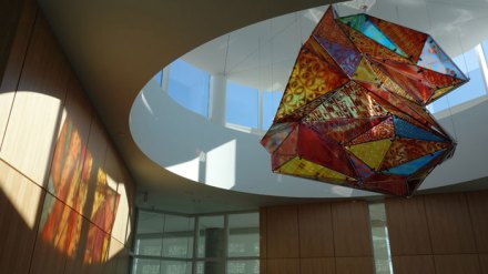"""""""Trans:Perspective"""" is a large glass sculpture that looks different from every angle."""