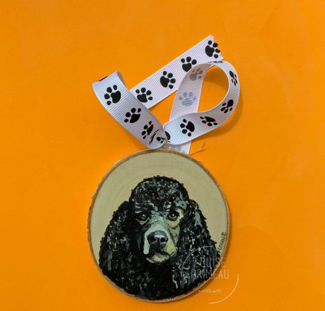 Standard Poodle portrait on wood slice
