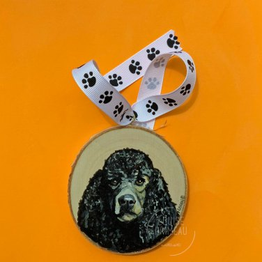 Standard Poodle portrait on wood slice