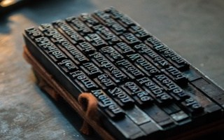 Blog post on 'self-publishing': photo of movable metal type pieces on a composing stick