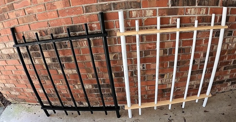 Two 3' sections of Halloween DIY faux wrought iron fencing with one painted black and the other not yet.