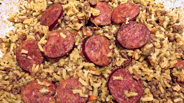 Rice and sausage in a jambalaya.