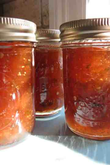 Fig Pepper Jelly in glass jars with lids.