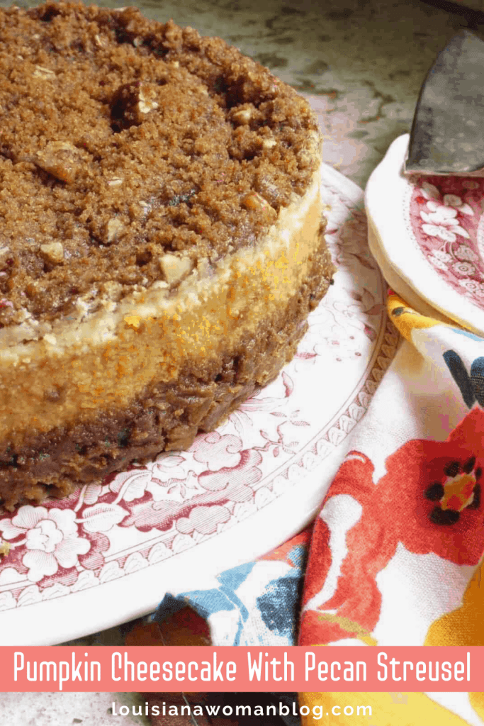A plate of cheesecake with pecan streusel on top