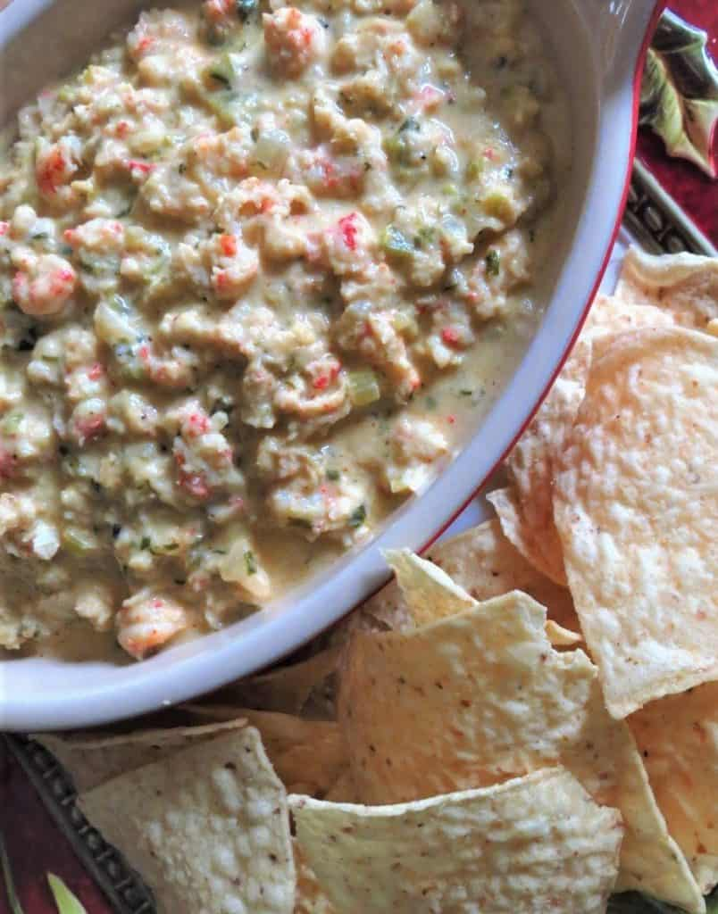 A bowl of Chunky Cheesy Creamy Crawfish Dip with tortilla chips.