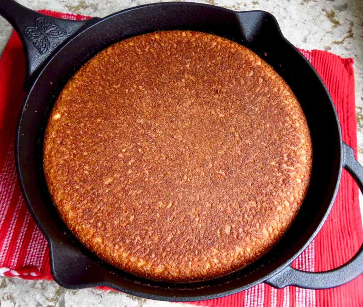 Iron Skillet Cornbread turned upside down in black iron skillet.