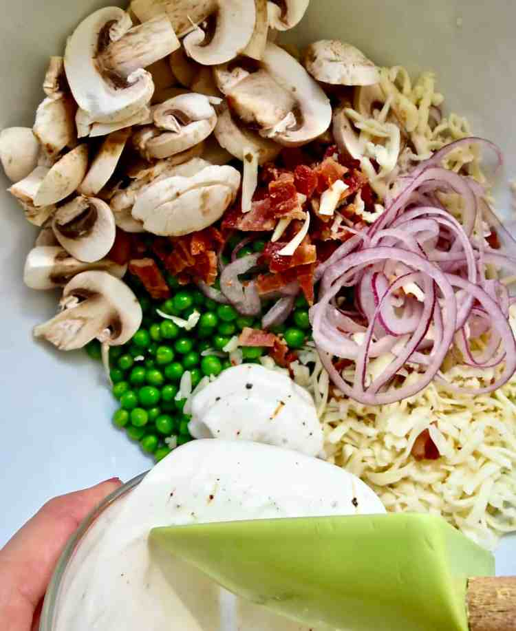 Ingredients in a white bowl to the Pea Salad, The Forgotten Side Dish.