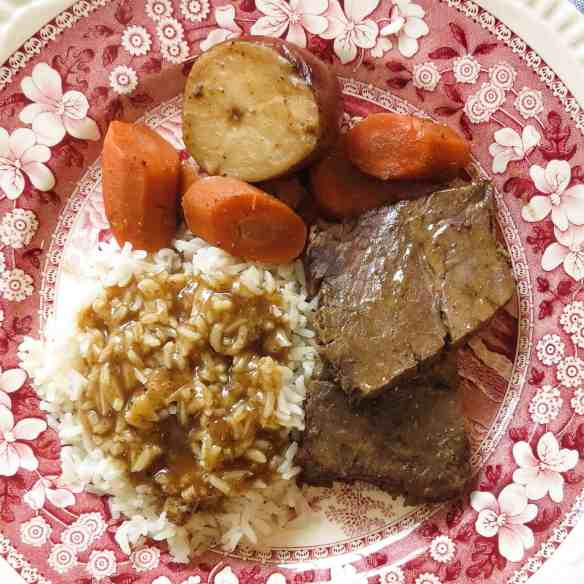 A red and white toile plate of rice and gravy, roast, carrots and potato for Rice and Gravy, A Cajun's Staple