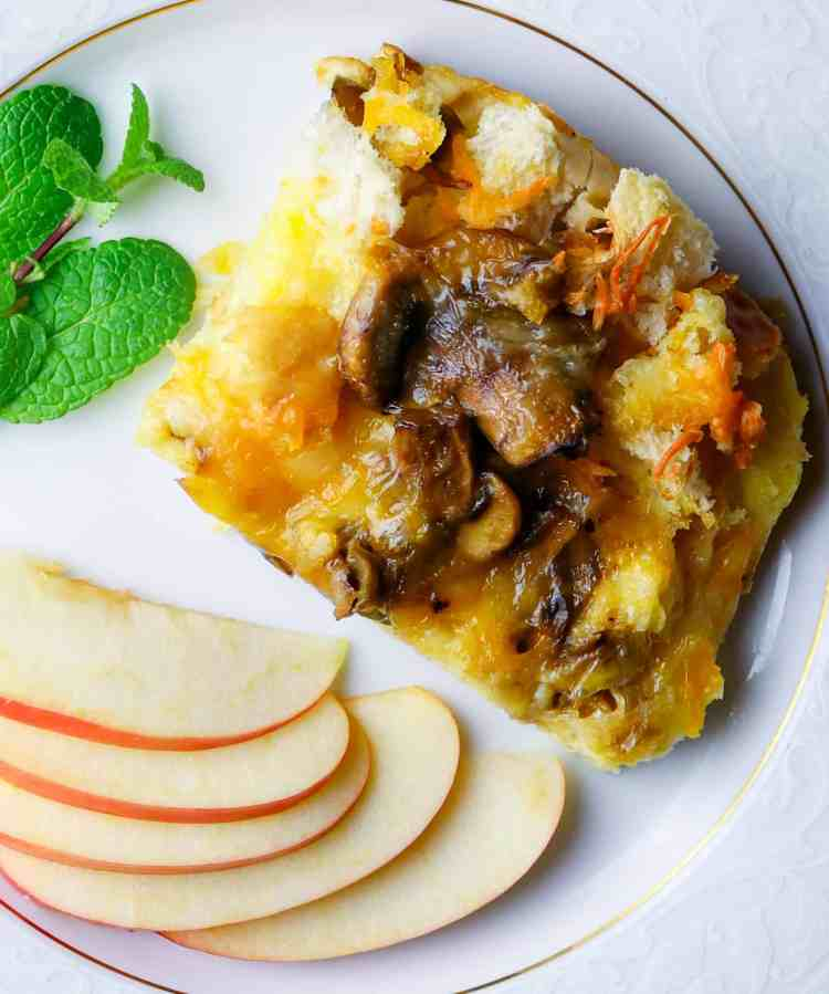 Plate of sliced apples and Easy Vegetable Breakfast Casserole with fresh mint.