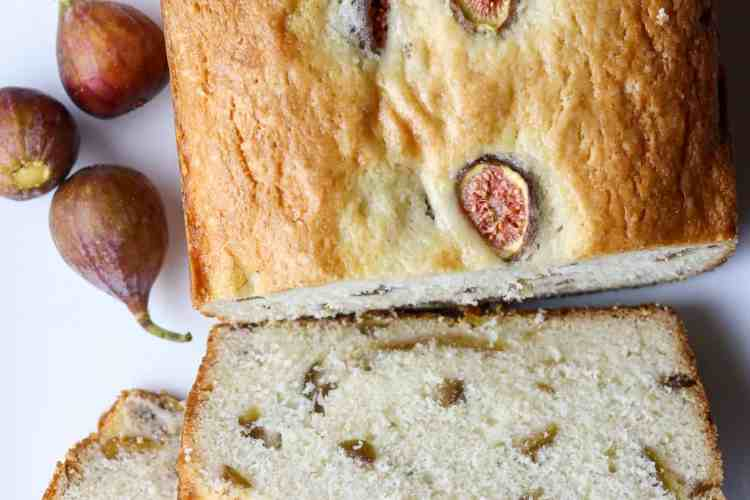 A loaf of fruit bread and figs.