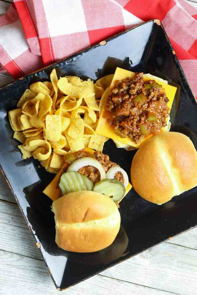 A plate of Homemade Sloppy Joes sliders with chips.