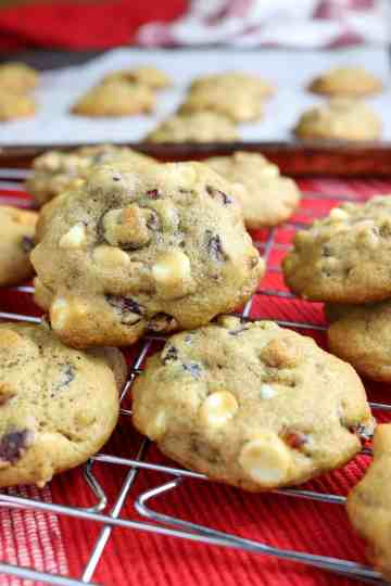 A stack of cookies on a cooling rack.