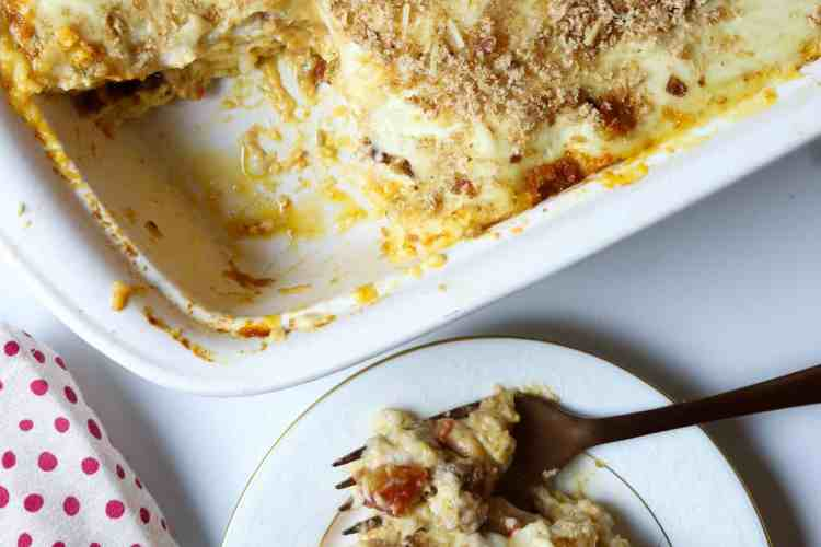 A plate of lasagna with a forkful and a casserole dish of lasagna.