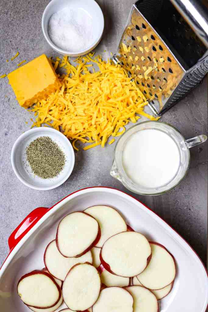 Ingredients of potatoes, cheese, and cream for a Cheese Potato Casserole.