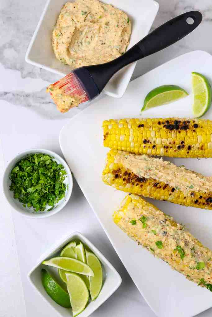 Roasted corn on the cob with cilantro and lime.