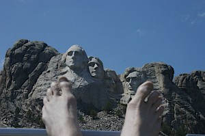 Klee's bare feet, Mt. Rushmore and blue sky in background