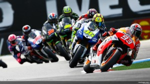MotoGP racers cornering at Assen