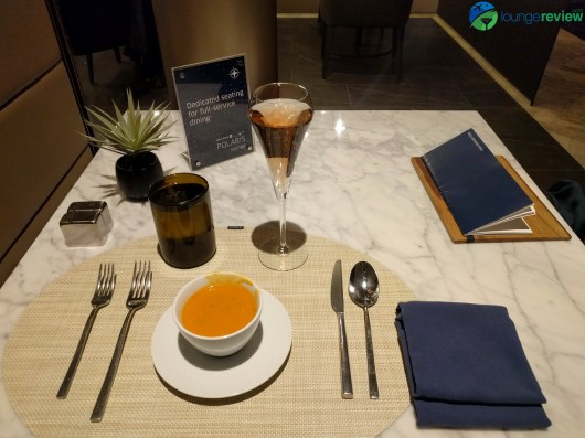 United Polaris Lounge Chicago O'Hare restaurant service: Basil tomato soup