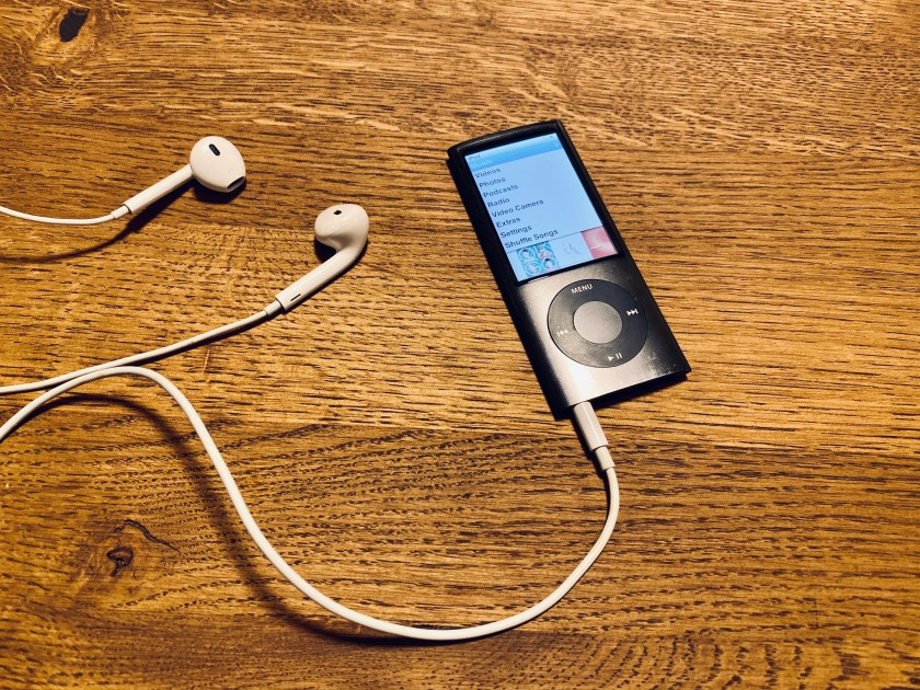 Martin's iPod nano (5th Generation) with later EarPods on a wooden table