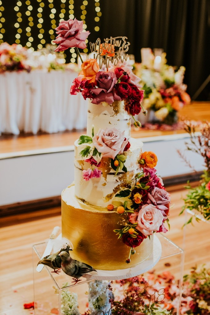 Tiered wedding cake with flowers
