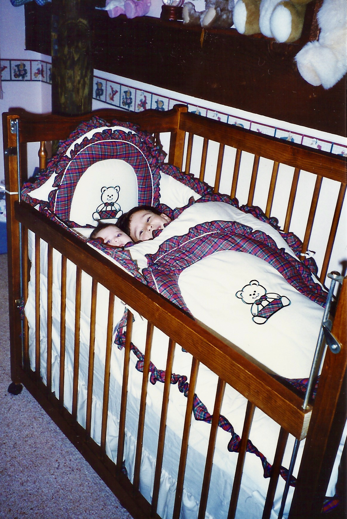 Me and my sister when she was a baby, sharing her cot