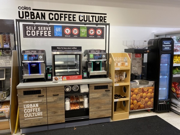 A coffee stand with the sign 'Coles Urban Coffee Culture'