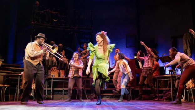 Amber Gray and the company of Hadestown. Photo by Helen Maybanks.