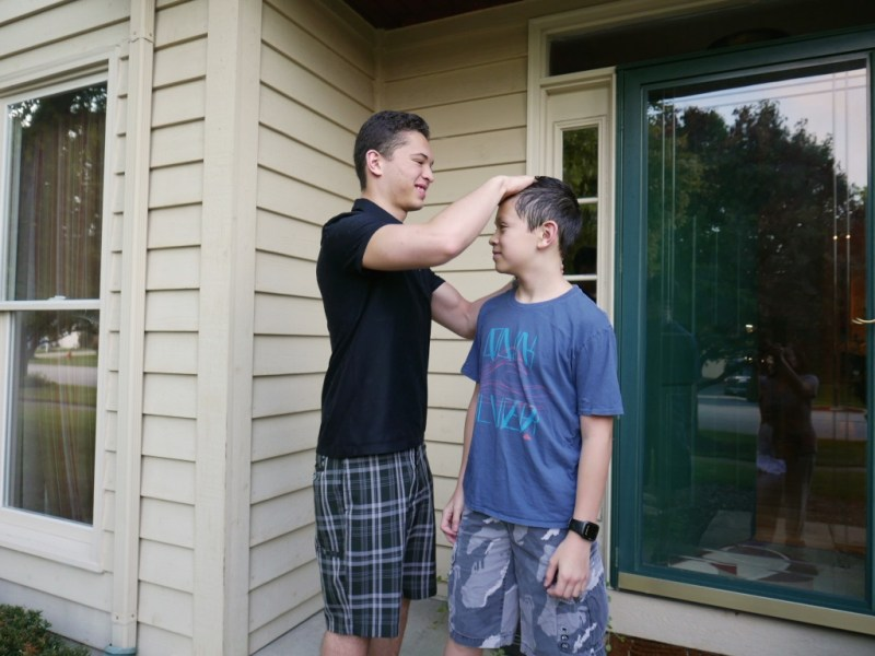 Hair adjustment by big brother