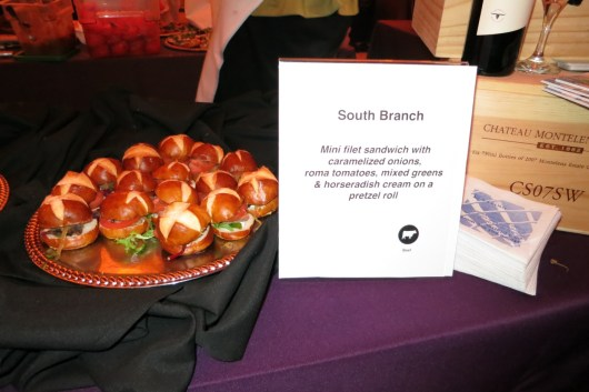 Filet of Beef, Caramelized Onion, Tomato, Green, Horseradish Cream, Pretzel Roll by South Branch