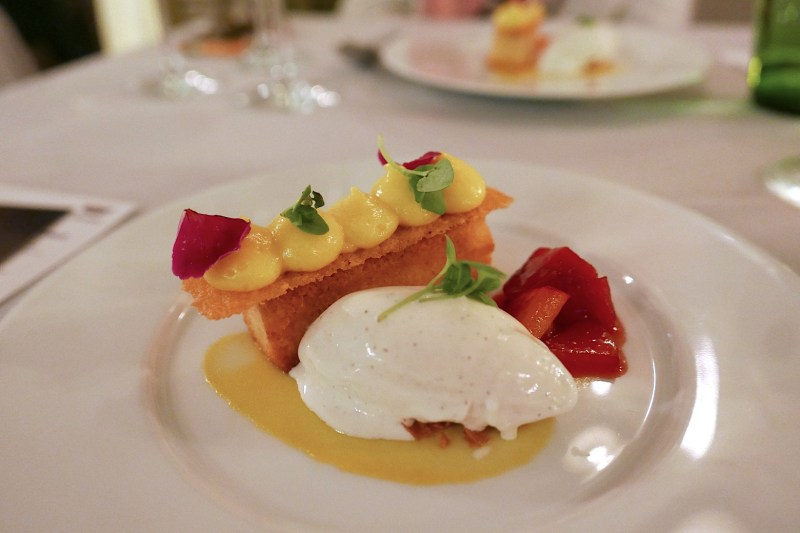 Coconut financier, passion fruit curd, stone fruit, vanilla ice cream