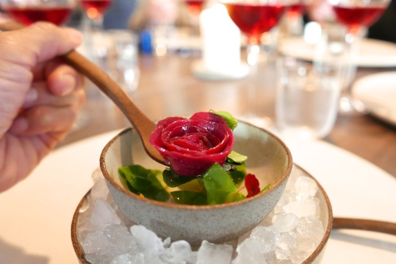 Opening dish. Rhubarb rose cooked with kelp and rose oil, sorrel leaves