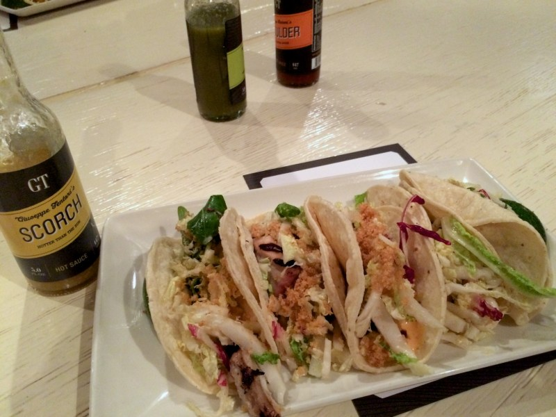 Fish tacos, garlic marinade, chipotle aioli, pork chicharron
